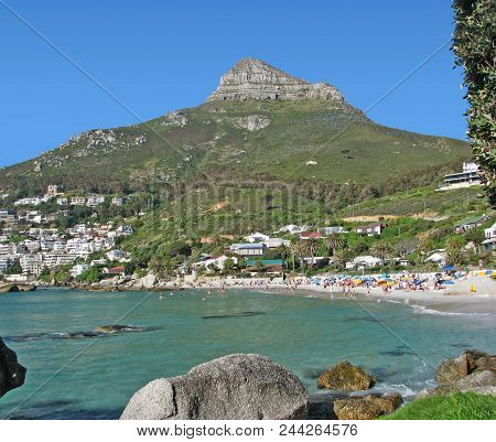 This Is Clifton, Cape Town, South Africa, With Rocks In The Fore Ground And A Calm Turquoise Sea Beh