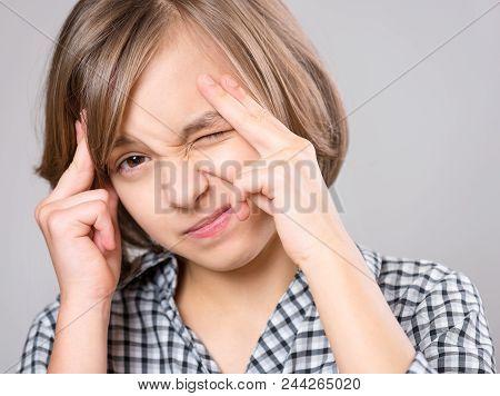 Stress And Headache - Teen Girl Having Migraine Pain. Cute Child Suffering From A Headache. Unhappy