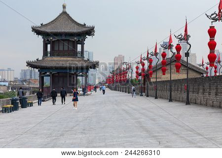 Xian, China - May 23, 2018:  Tourists Walk On The South Gate Of Xian City Wall ,one Of The Oldest An
