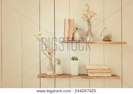 Old  Book And Flowers In A Vase On A Wooden Shelf, Frame With Flowers On A Wooden Wall. Wooden Shelv