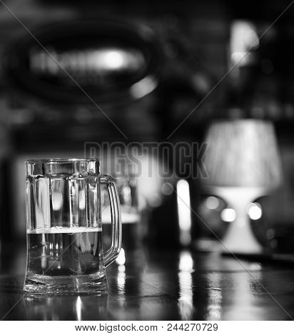 Glass Of Draft Beer On Blurred Bar Background, Close Up. Glass Of Light Beer. Alcohol And Catering C
