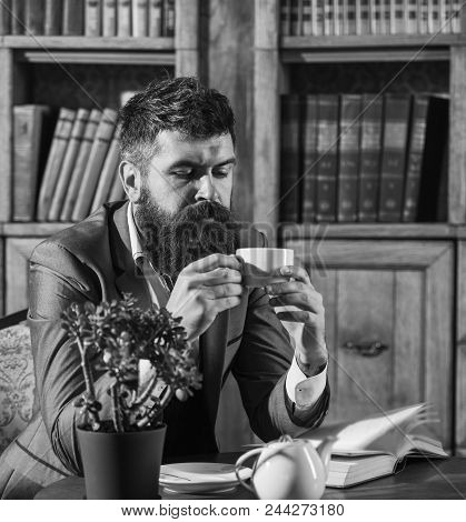 Read In The Library. Oldfashioned Man Holds Cup With Tea. Aristocratic Lifestyle Concept. Aristocrat