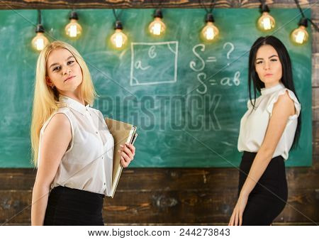Ladies Ready To Start Private Lesson, Chalkboard On Background. Teachers In Formal Wear With Book An