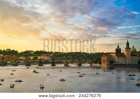 View Of The Famous Charles Bridge On A Cloudy Sky At Sunset. Charles Bridge Is A Historic Gothic-sty