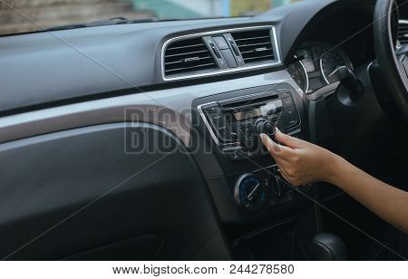 Hand Driver Touching The Screen And Turning On Car Radio System,button On Dashboard In Car Panel