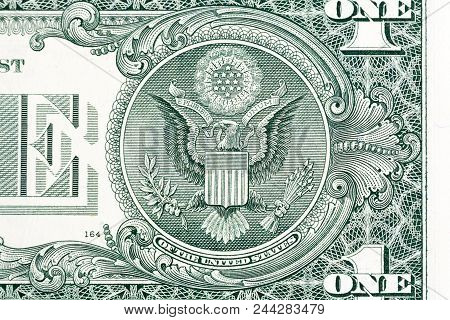 The Seal Of The United States With E Pluribus Unum Motto On The Reverse Side Of One American Dollar
