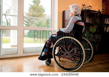 Loneliness Senior Woman Sitting In Wheelchair At Nursing Home
