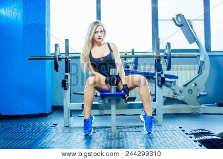 Brutal Fitness Sexy Woman With A Muscular In The Gym. Sports And Fitness - Concept Of Healthy Lifest