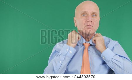 Businessperson Arranging His Tie With Green Screen In Background