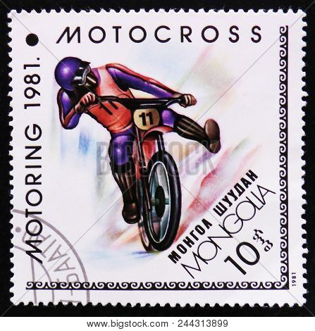 Moscow, Russia - April 2, 2017: A Post Stamp Printed In Mongolia Shows Motocross, Motoring Serie, Ci