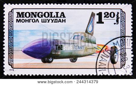 Moscow, Russia - April 2, 2017: A Post Stamp Printed In Mongolia Shows Blue Flame Transport Airplane