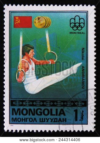 Moscow, Russia - April 2, 2017: A Post Stamp Printed In Mongolia Shows Nikolai Andrianov, Montreal G
