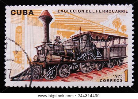 Moscow, Russia - April 2, 2017: A Post Stamp Printed In Cuba Shows Moving Train And Devoted Evolutio