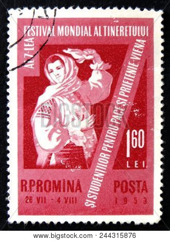 Moscow, Russia - April 2, 2017: A Post Stamp Printed In Romania Shows Dancing Woman In National Dres