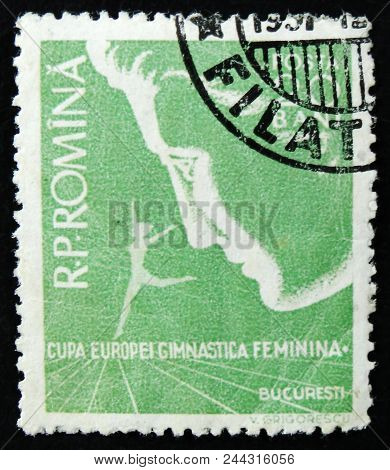 Moscow, Russia - April 2, 2017: A Post Stamp Printed In Romania Shows Woman Face And Europe Women Gy