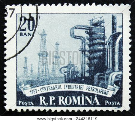Moscow, Russia - April 2, 2017: A Post Stamp Printed In Romania Shows Petroleum Plant, Circa 1957