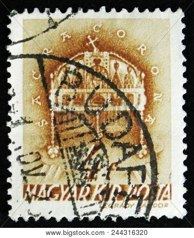 Moscow, Russia - April 2, 2017: A Post Stamp Printed In Hungary Shows Holy Crown Of St. Stephen, 900