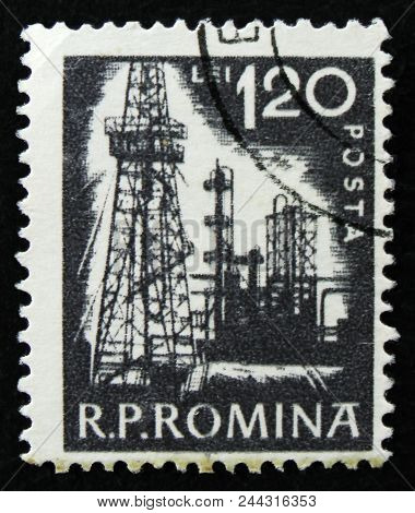 Moscow, Russia - April 2, 2017: A Post Stamp Printed In Romania Shows Petroleum Refinery, Circa 1960
