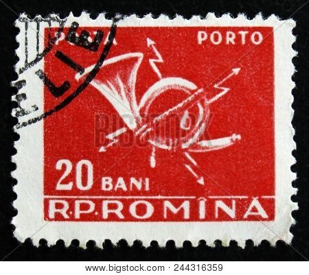 Moscow, Russia - April 2, 2017: A Post Stamp Printed In Romania Shows Post Horn, Circa 1967