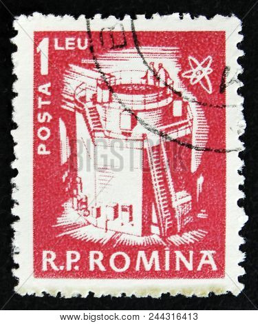 Moscow, Russia - April 2, 2017: A Post Stamp Printed In Romania Shows Atomic Reactor, Circa 1960
