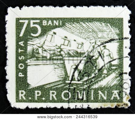 Moscow, Russia - April 2, 2017: A Post Stamp Printed In Romania Shows Cattle Feeding, Farm Workers,
