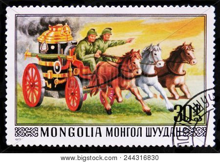 Moscow, Russia - April 2, 2017: A Post Stamp Printed In Mongolia Shows Firefighting Carriage And Hor
