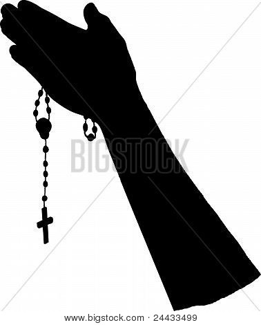 Praying hands with rosary beads crucifix