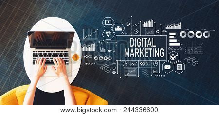 Digital Marketing With Person Using A Laptop On A White Table