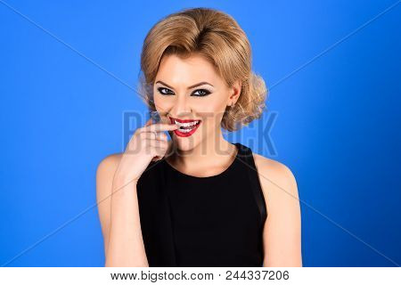 Sexy Blonde Girl With Evening Makeup On Blue Background. Beauty And Fashion. Skin And Face Care. Blo