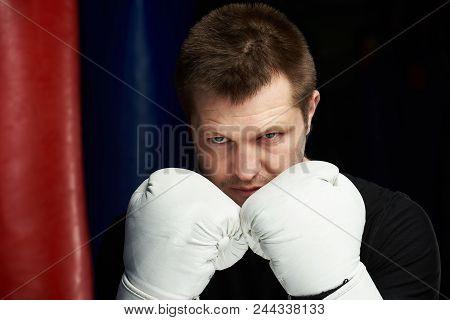 Close-up Of Boxing Man Behind Gloves Defense. Defense Concept