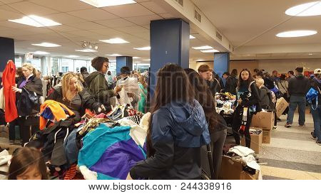 People Shopping At The Francis Parker School Garage Sale, Chicago, Il May 20, 2017