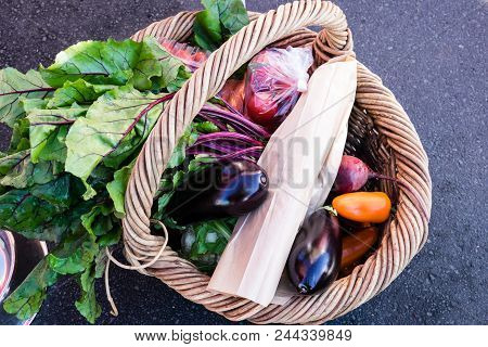 Wicker Shopping Basket Of Fresh Vegetables And Produce At A Farmers Market In New Zealand, Nz