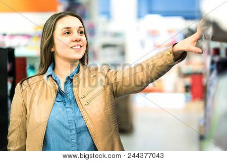 Woman At Beauty Product Shelf In Supermarket Or Buying Medicine In Pharmacy Or Drugstore. Smiling La