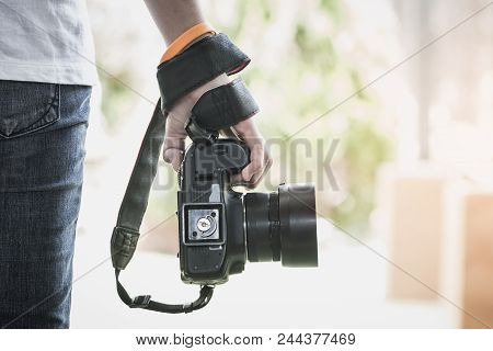 Professional Photographer Landscape With Dslr Camera In Smart Woman Hands For Ready To Take Pictures