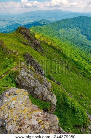 Boulders Along The Mountain Ridge. Location Pikui Mountain. Borzhava Mountain Ridge In The Far Dista