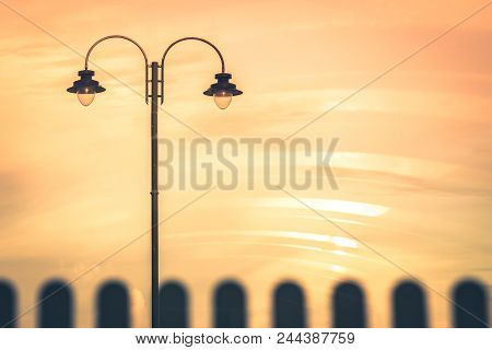 Picture Of A Street Lamp During Orange Sunset, Penzance, Cornwall, Uk