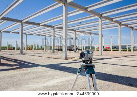 Surveyor Instrument Is For Measuring Level On Construction Site. Surveyors Ensure Precise Measuremen