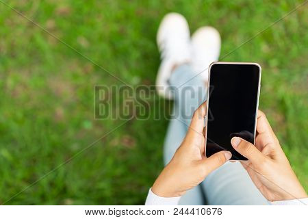 Woman Using Smartphone, Woman Pointing Finger On Blank Screen Smartphone On Green Background, Hipste