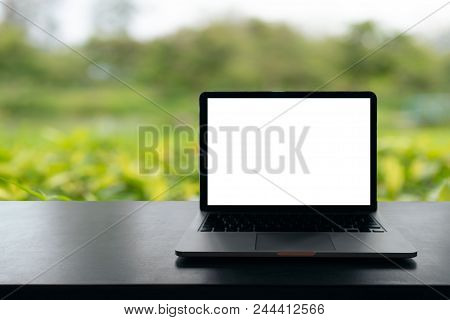 Laptop With Blank Screen On Table, Conceptual Workspace, Laptop Computer With Blank White Screen On
