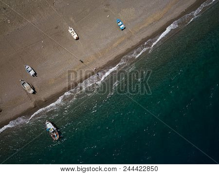 Sea Shore, Little Fishing Boats Are Parking At The Beach, Drone Brids Eye View, Sicily, Italy