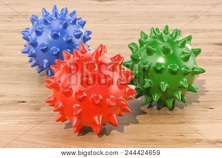 Set Of Colored Spiky Balls For Massage Or Toy For Pets On The Wooden Table. 3d Rendering