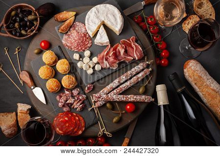 Appetizers Table With Differents Antipasti, Cheese, Charcuterie, Snacks And Wine. Mini Burgers, Saus