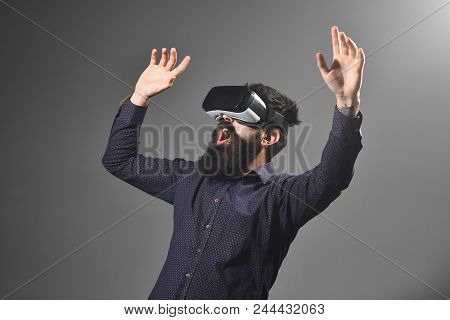 Emotional Bearded Man Wears Virtual Reality Goggles, Gesturing With Hands. Connection, Future Techno