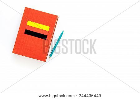 Language Study Concept. Textbooks Or Dictionaries Of Foreign Language Near German Flag On White Back