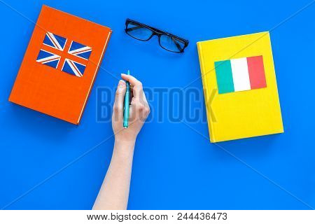 Language Study Concept. Textbooks Or Dictionaries Of Foreign Language Near Italian And Great Britain