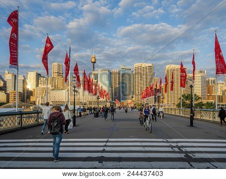 Sydney, Australia - May 22, 2017: Lamps, Flags And People Activities On The Historic Pyrmont Bridge.