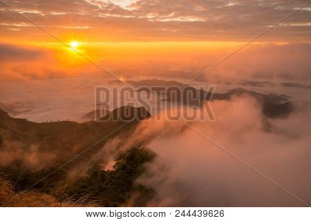 The Beautiful Sunrise Over Landscape Of The Sea Mist Cover The Highland Mountains Named Phu Chi Dao