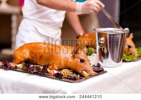 Baked Piglet With Vegetables And Gravy. Festive Show.