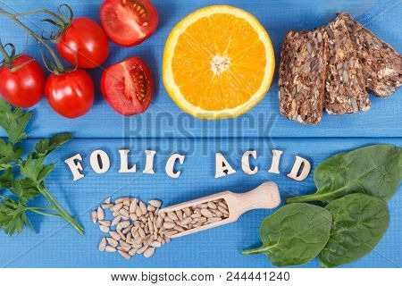 Inscription folic acid with nutritious food as source vitamin B9, dietary fiber and natural minerals, concept of healthy lifestyles poster
