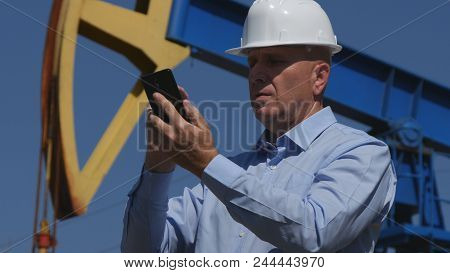 Petroleum Engineer Working In Extracting Oil Industry Using Mobile Phone Communication